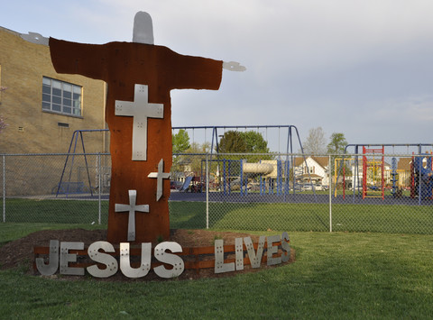 1446663079outside-jesus_with_playground